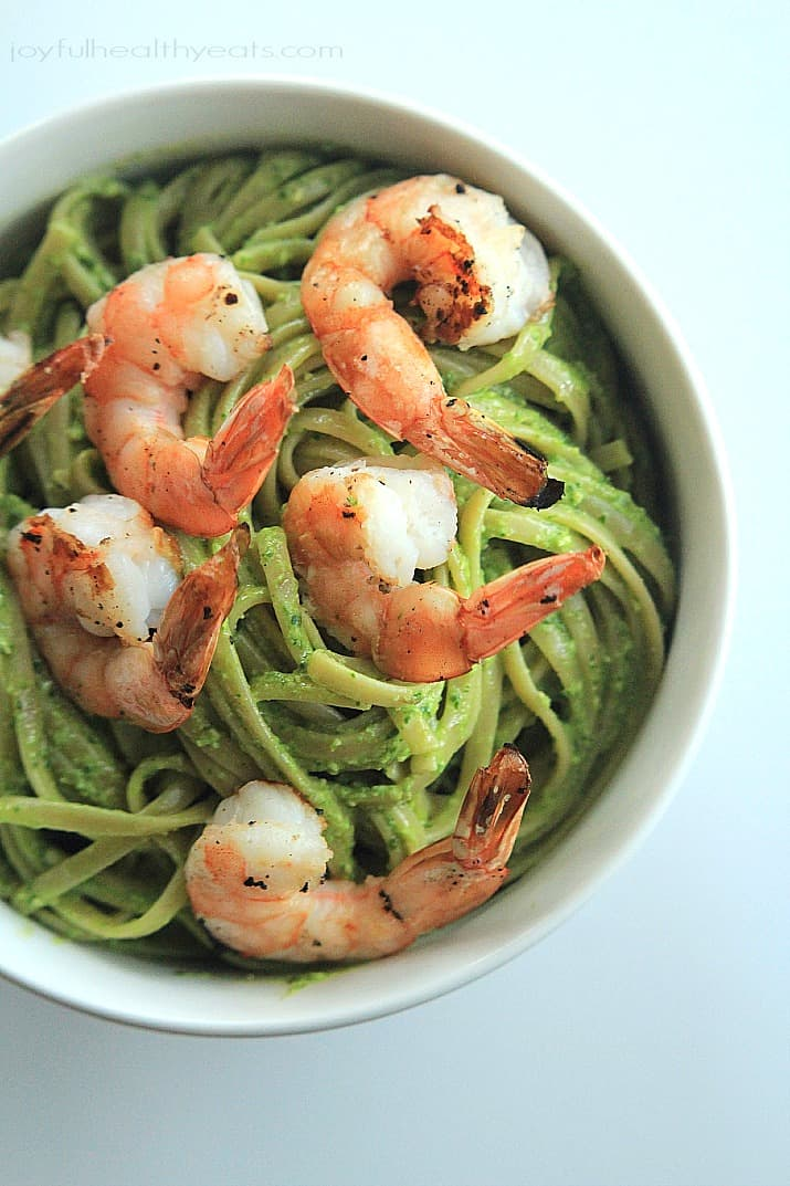 Top view of Goat Cheese Spinach Pesto Pasta with Grilled Shrimp in a bowl
