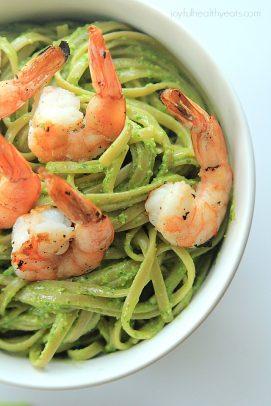 A bowl of pesto pasta with shrimp