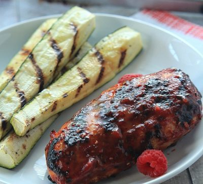 The ultimate grilled dinner, done in less than 30 minutes! Grilled Chicken Breast with Raspberry Chipotle BBQ Sauce | www.joyfulhealthyeats.com