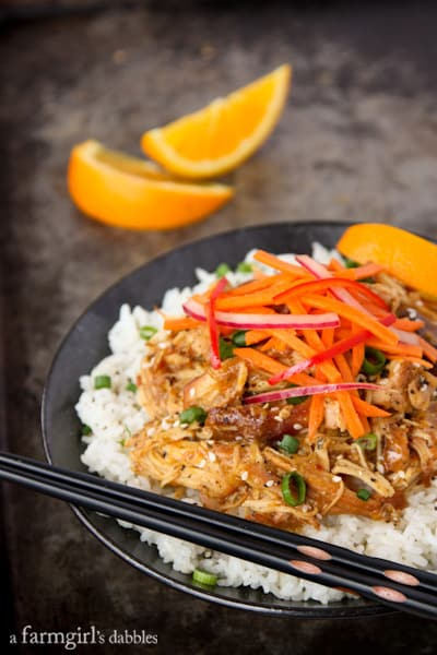 A Plate of Orange Chicken with Fresh Asian Slaw and a Pair of Chopsticks