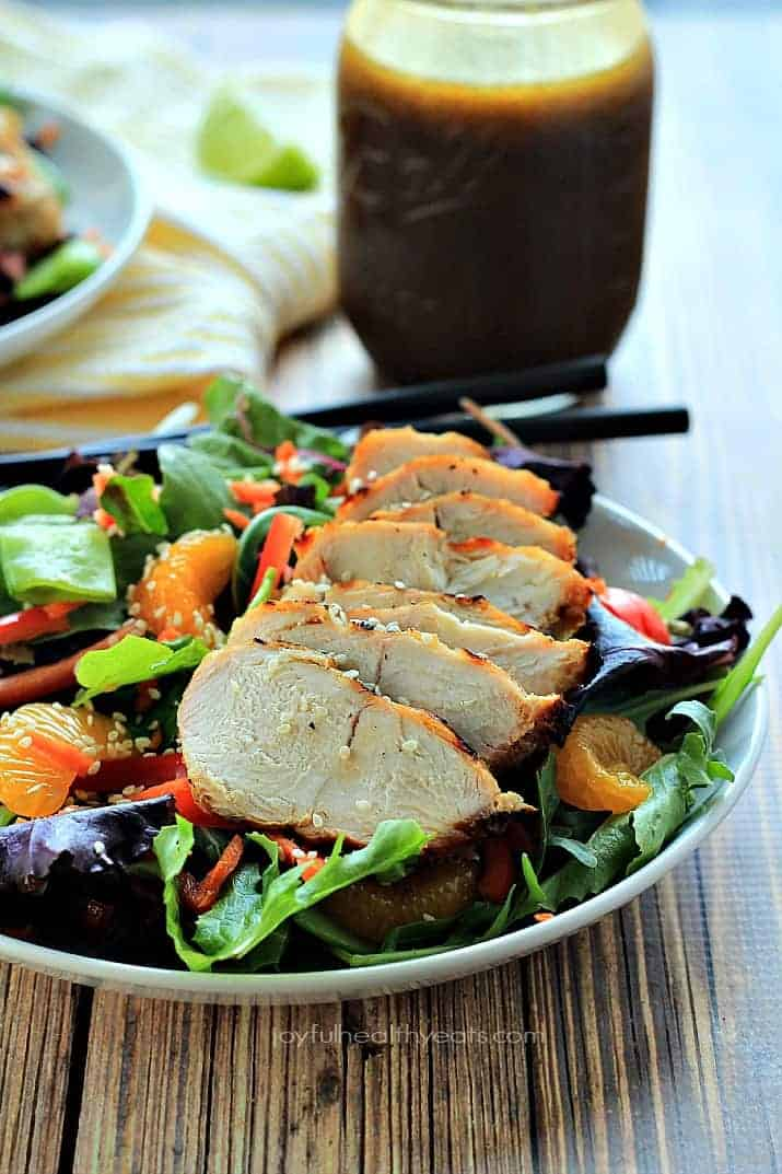 Skip the take-out make this healthy Asian Chicken Salad with Sesame Ginger Dressing in less than 30 minutes! | www.joyfulhealthyeats.com