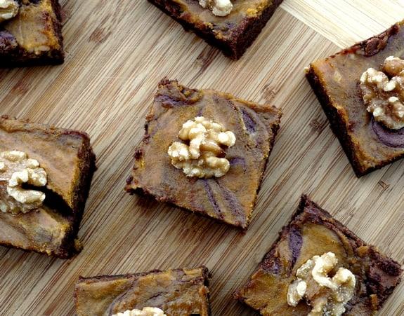 Seven Fudgey Pumpkin Brownies Arranged on a Wooden Surface