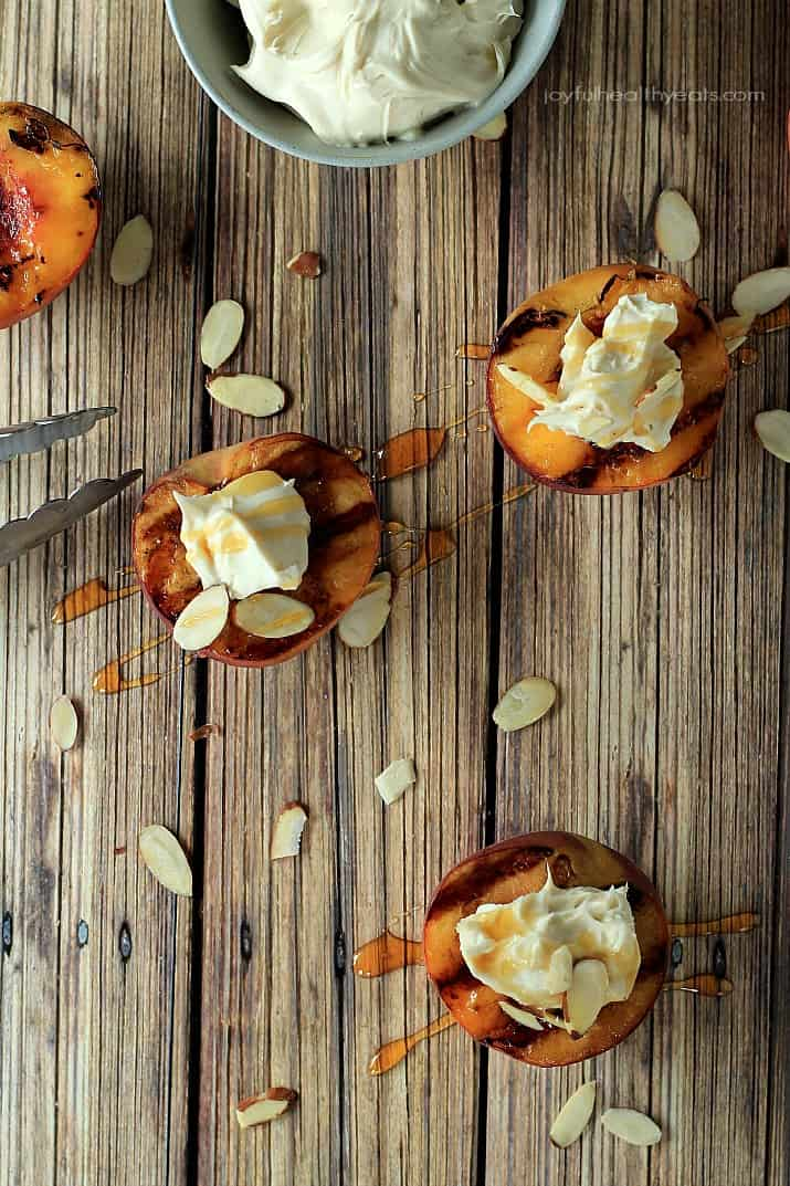 Top view of Grilled Peaches with Maple Honey Mascarpone Cheese on a wooden board
