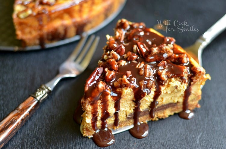 A Slice of Pumpkin Chocolate Cheesecake Next to Two Metal Forks