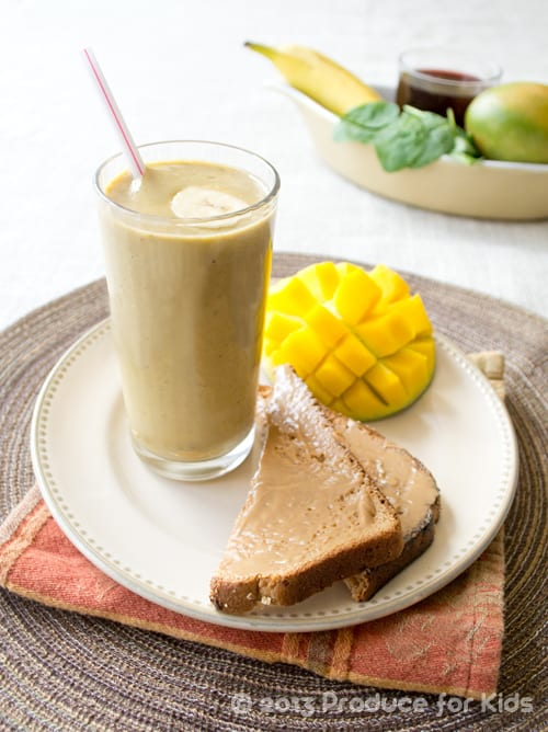 A Fruity Pumpkin Smoothie on a Plate with Toast and a Mango