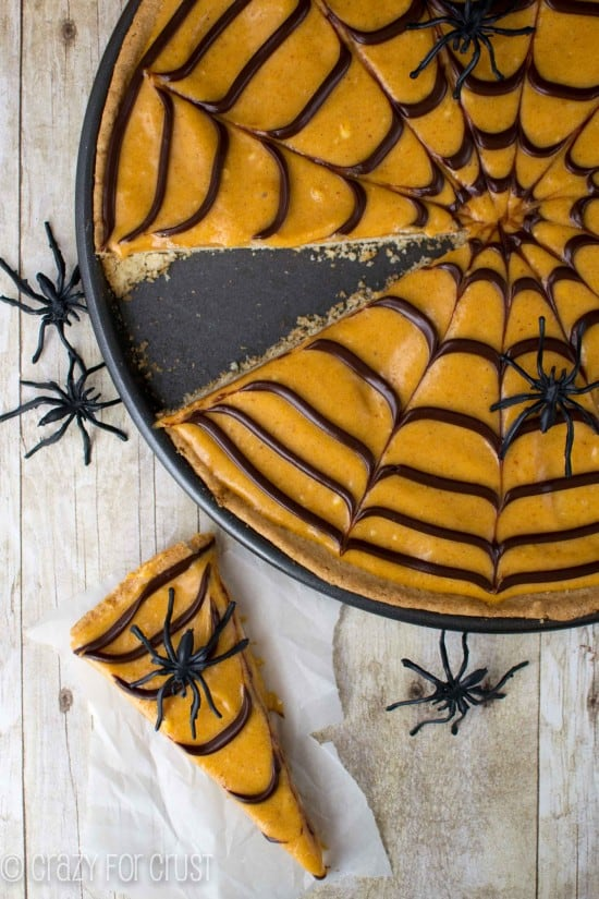 A Pumpkin Spice Spiderweb Cookie Pizza with One Slice Removed