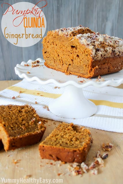 Two Slices of Pumpkin Quinoa Gingerbread Beside the Loaf on a Cake Stand