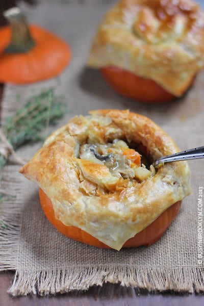 A Pumpkin Chicken Pot Pie with a Metal Spoon Diggin Into the Filling