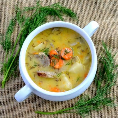Cheddar and Bratwurst Soup with Pumpkin Ale in a bowl