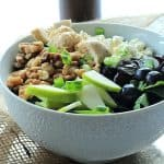 A Bowl of Chicken Feta Walnut Grape Salad Beside a Bottle of Honey Balsamic Vinaigrette