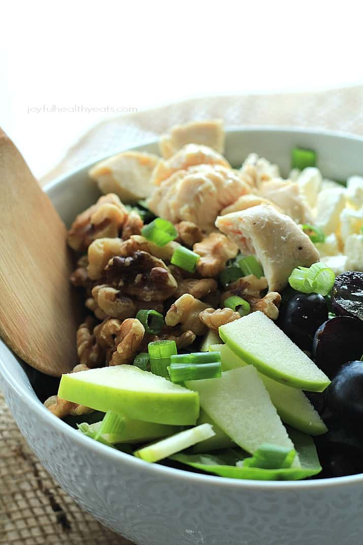 A Chopped Salad in a Bowl with Walnuts, Chicken and Green Apple Slices