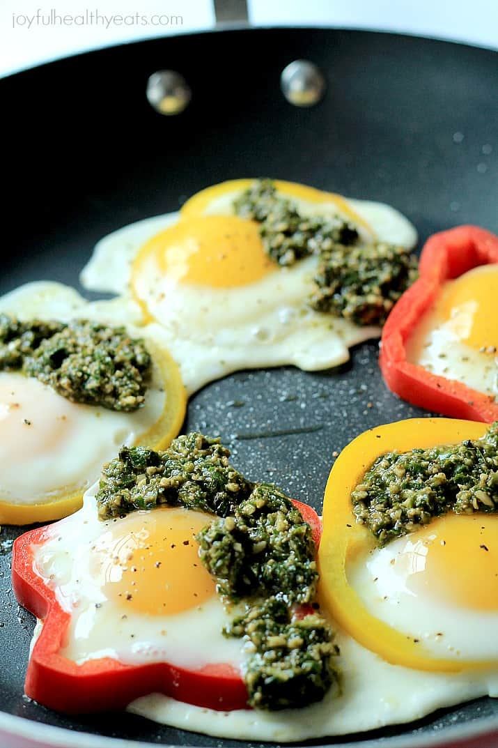 Eggs in a Hole with bell pepper rings and Basil Pesto in a skillet
