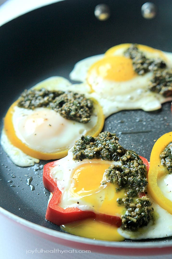 Egg in a Hole with Basil Pesto and bell pepper rings in a skillet