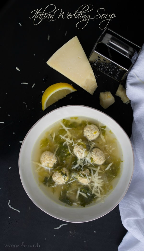 A Bowl of Italian Wedding Soup Topped with Freshly Grated Cheese