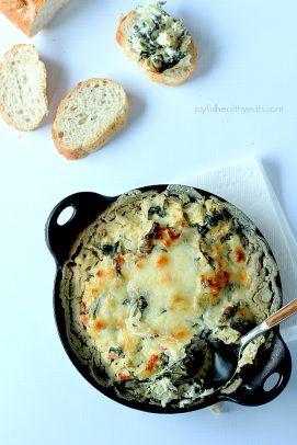 Creamy Kale Spinach Artichoke Dip in a cast iron pot