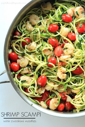 Shrimp scampi and grape tomatoes over zucchini nodles