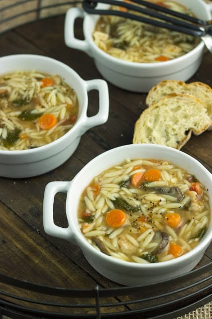Three Bowls of Spinach Chicken Orzo Soup with Two Slices of Bread