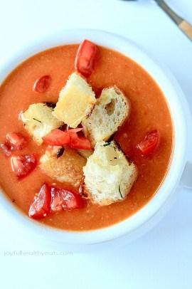 A hearty Tuscan Tomato Soup with Homemade Rosemary Garlic Croutons! | www.joyfulhealthyeats.com | #wintersoup #souprecipes #vegetarian #freezerfriendly