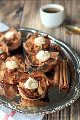 Apple Pie Wonton Cups on a Serving Tray with Cinnamon Sticks
