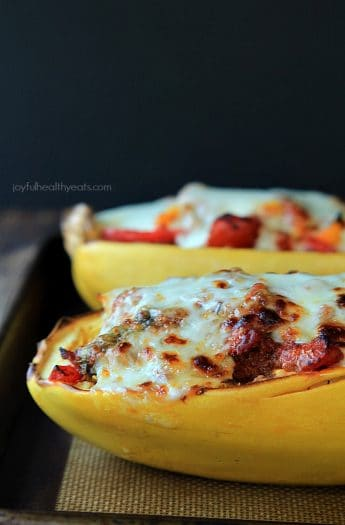 An easy healthy spanish inspired weeknight dinner, Chorizo Kale & Pepper Stuffed Spaghetti Squash Boats! | www.joyfulhealthyeats.com