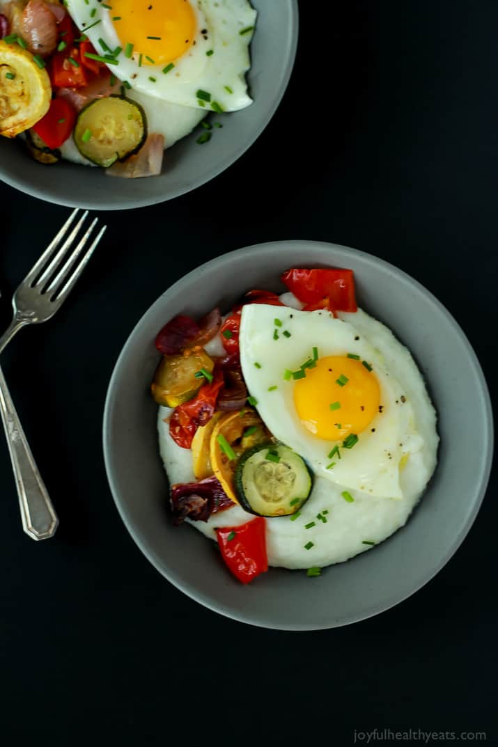 Two Gray Bowls of Grits, Eggs and Veggies with Silverware