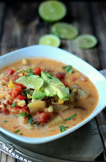 A Bowl of Crock Pot Southwestern Corn & Potato Chowder with Lime Slices