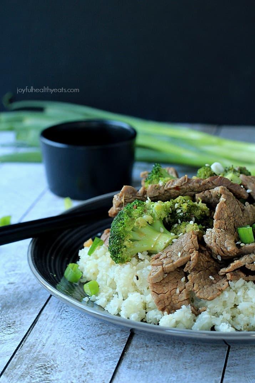 An easy to make Paleo & Gluten Free recipe packed with flavor! Beef & Broccoli Stir fry with Cauliflower Rice | www.joyfulhealthyeats.com