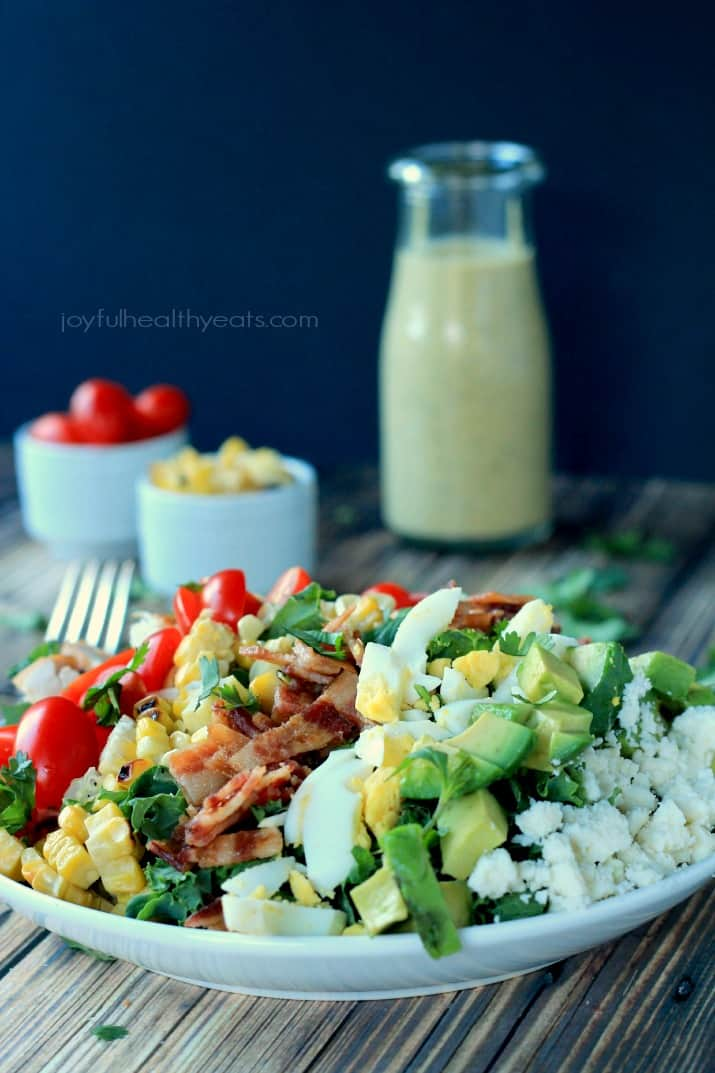A Healthy tex-mex inspired Cobb Salad that is absolutely killer tossed with a Creamy Poblano Dressing, | www.joyfulhealthyeats.com #saladrecipes #glutenfree