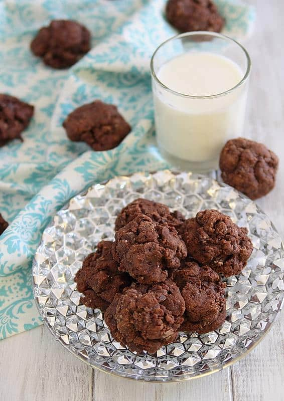 A Plate of Dark Chocolate Amaretto Fudge Cookies With a Cold Glass of Milk