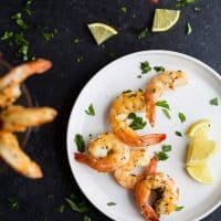 Easy 10 Minute Garlic Herb Roasted Shrimp served with a homemade Cocktail Sauce. These Roasted Shrimp are the ultimate Holiday Party Appetizer! So put that flavorless cocktail shrimp down and make these! I guarantee you'll fall in love!