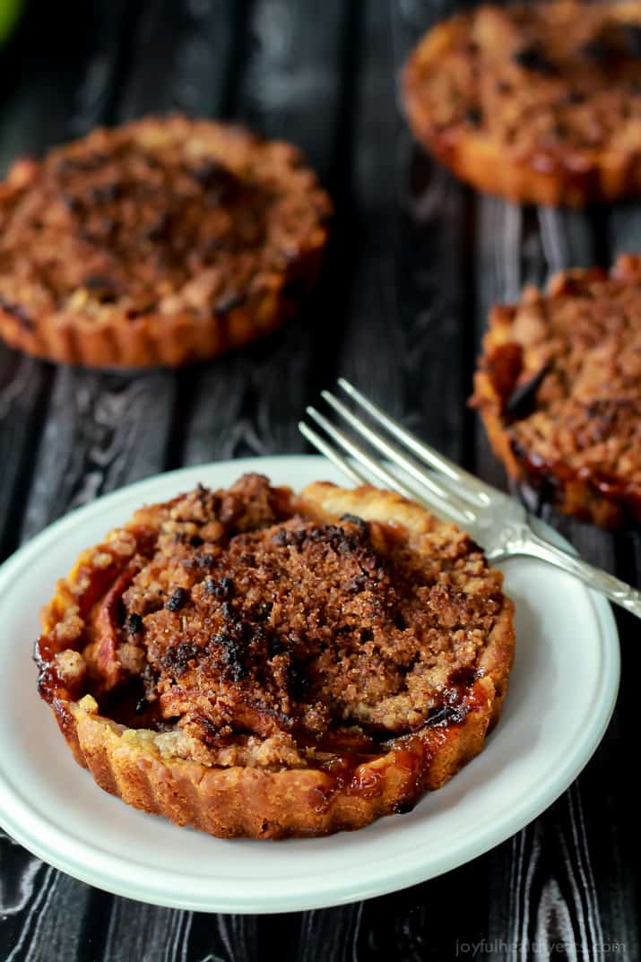 Built in portion control makes these Mini Apple Pie Tartlets with Pecan Streusel extra irresistible! The ultimate fall dessert! | www.joyfulhealthyeats.com Built in portion control makes these Mini Apple Pie Tartlets with Pecan Streusel extra irresistible! The ultimate fall dessert! | www.joyfulhealthyeats.com