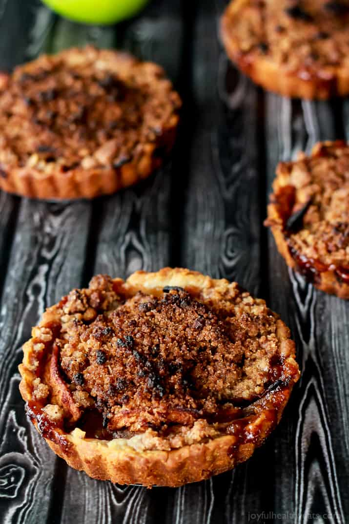 Built in portion control makes these Mini Apple Pie Tartlets with Pecan Streusel extra irresistible! The ultimate fall dessert! | www.joyfulhealthyeats.com