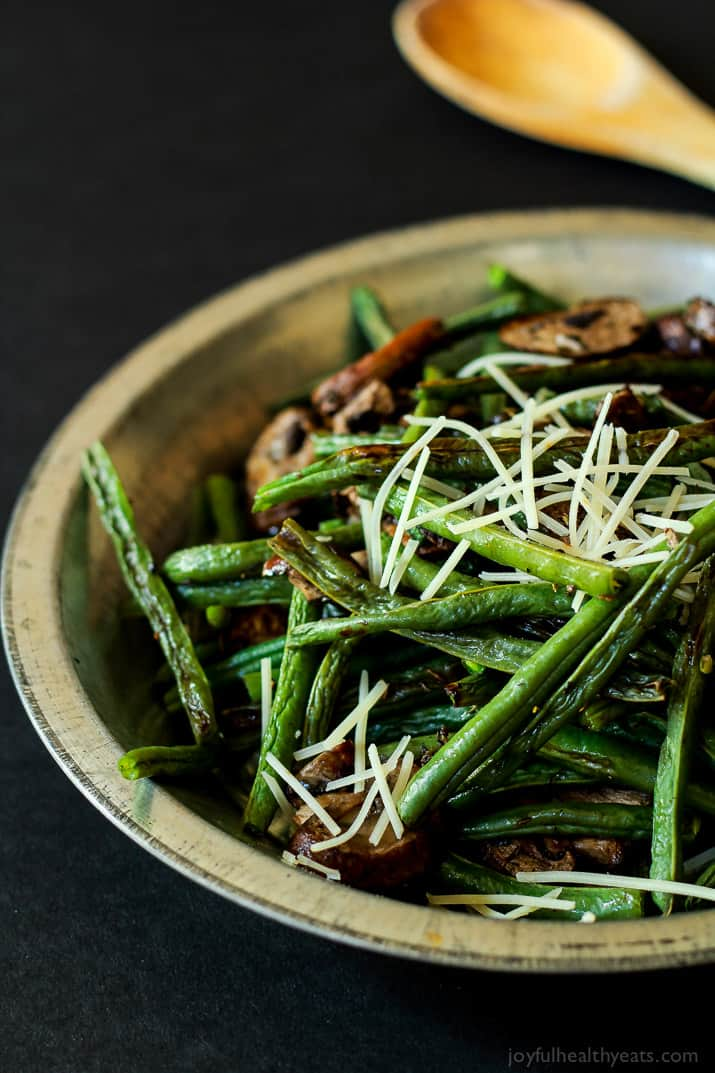 A much healthier version of Green Bean Casserole, fresh green beans & mushrooms mixed with thyme and lemon juice. | www.joyfulhealthyeats.com