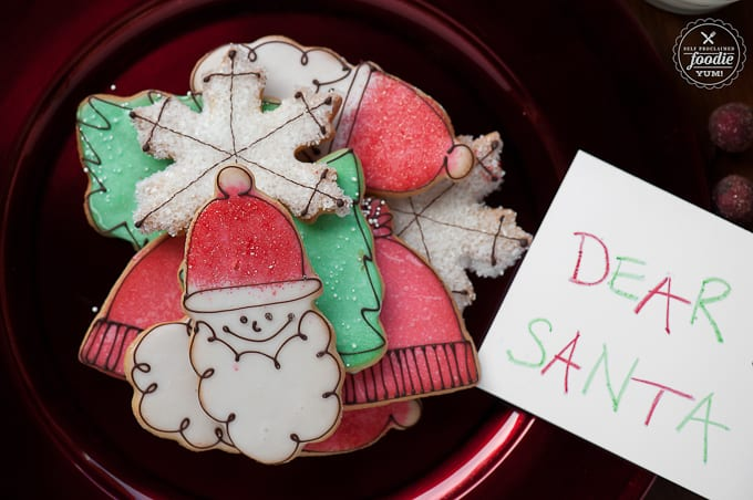 A Plate of Holiday Sugar Cookies Next to a Sign for Santa
