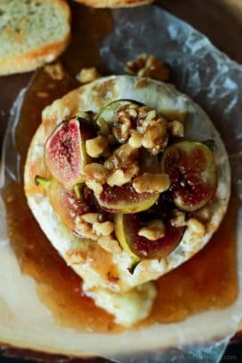 Top-down view of Baked Brie with Roasted Fig Honey Walnut Topping