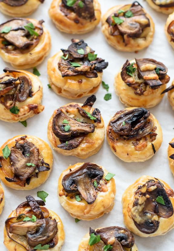 Cheesy Mushroom Puff Pastry Bites on a Piece of Parchment Paper