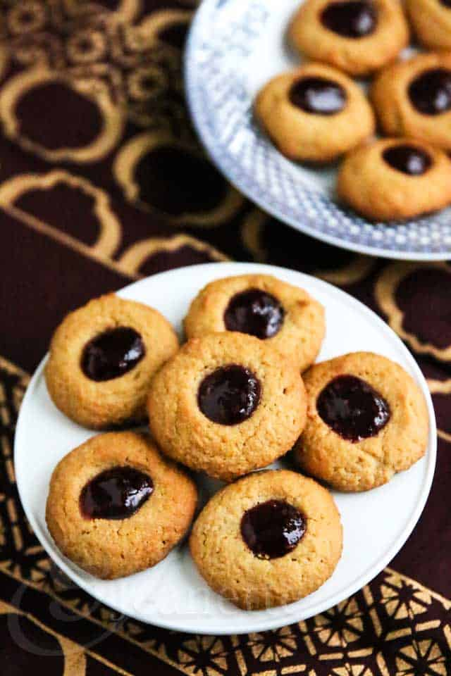 Two Plates of Peanut Butter and Jelly Thumbprint Quinoa Cookies