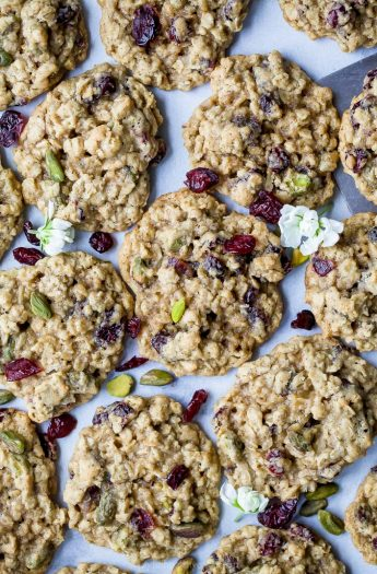 photo of Chewy Pistachio Cranberry Oatmeal Cookies on parchment paper