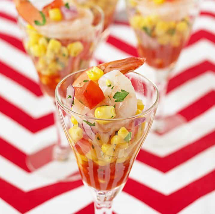 A Shrimp and Corn Salsa Shooter with a Red and White Striped Background