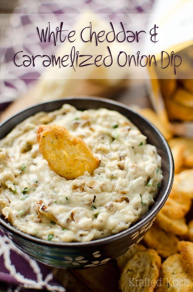 White Cheddar Caramelized Onion Dip in a Black Bowl with White Flowers