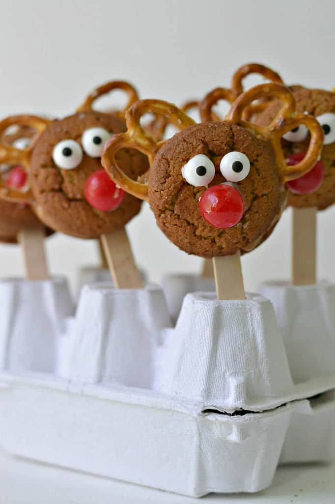 Four Reindeer Cookie Pops Propped Up with an Egg Carton