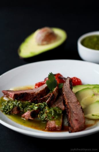 Healthy + Easy Chili Rubbed Flank Steak served with fresh chimichurri sauce, done in 30 minutes. Soooo stinking good! | www.joyfulhealthyeats.com #recipes #eathealthy #glutenfree