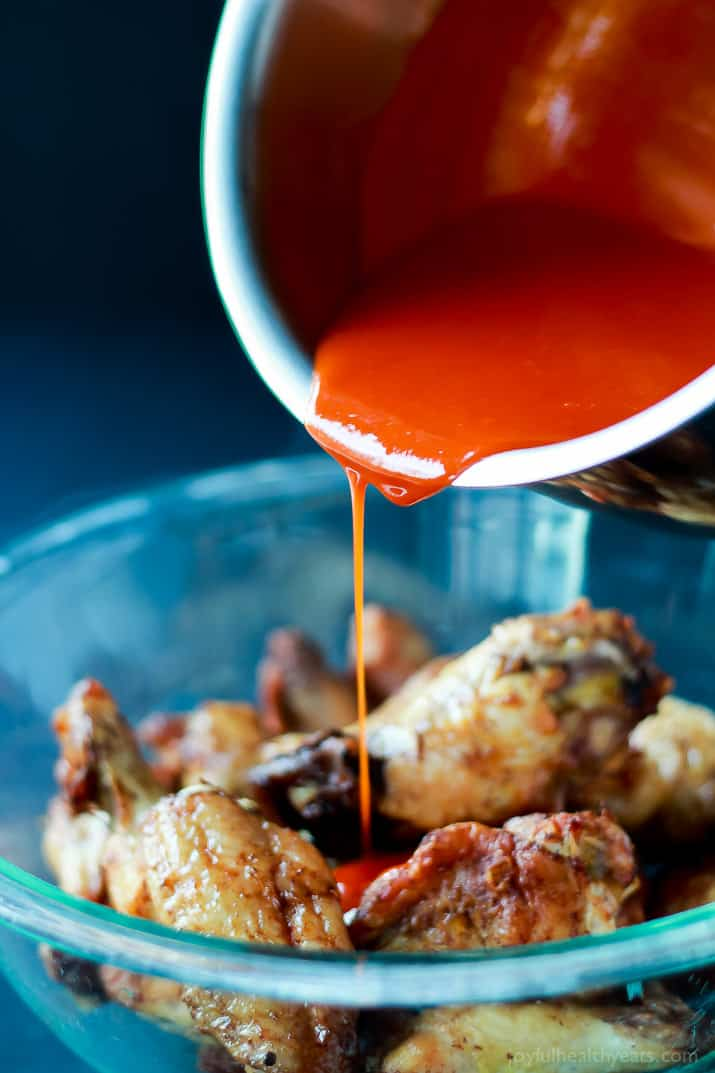 A healthier version of the Classic Buffalo Baked Chicken Wings, these are baked and still have the same crispy sauce taste! | www.joyfulhealthyeats.com #recipes #appetizer