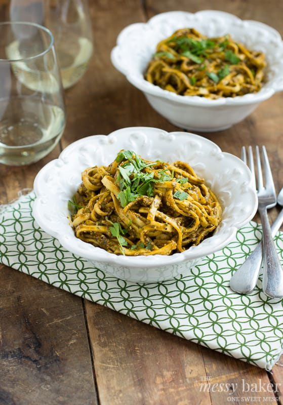 Two Bowls of Roasted Red Pepper Pesto Pasta with Two Glasses of White Wine