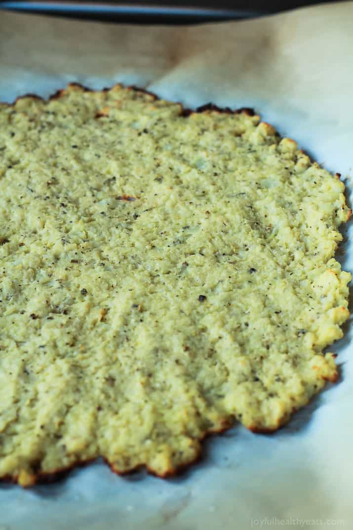 Done in 30 Minutes! An Easy Gluten Free Herb Cauliflower Pizza Crust recipe that is full of flavor and takes less time to make them homemade pizza dough. | joyfulhealthyeats.com #recipe