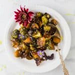 photo of honey soy roasted brussels sprouts on a plate