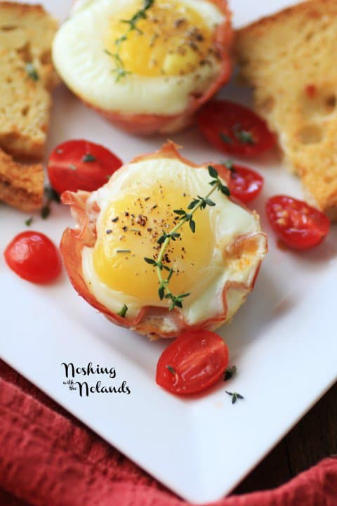 A Ham and Egg Cup Surrounded by Halved Cherry Tomatoes