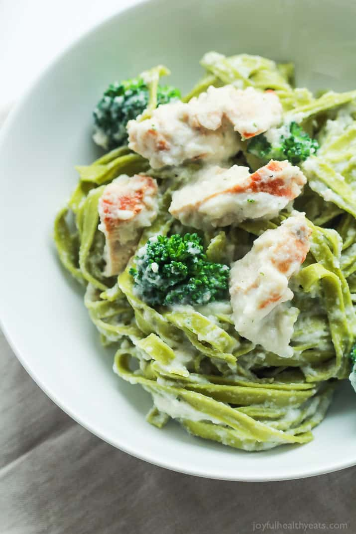 Skinny Chicken Alfredo Pasta made with Cauliflower Alfredo Sauce, Fresh Spinach Pasta, and Broccoli - all on the table in 30 minutes! YES please! | joyfulhealthyeats.com #recipes