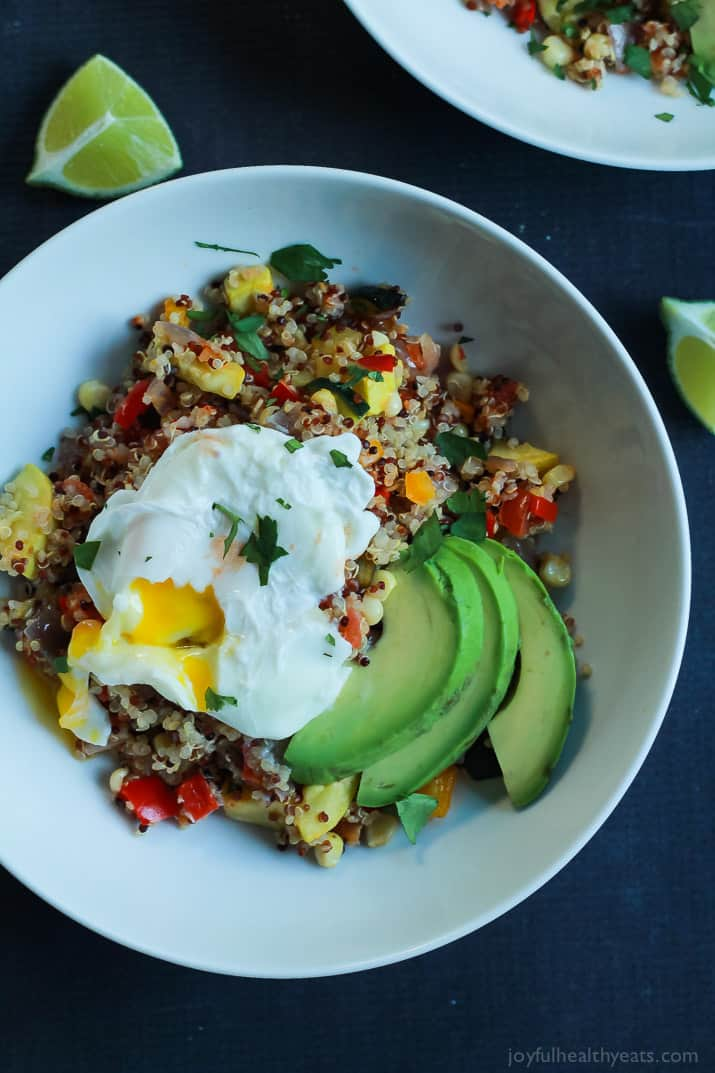 A heart healthy Southwestern Roasted Vegetable Quinoa Salad packed with protein and loads of flavor then topped with a poached egg and fresh avocado! Holy Yum! | joyfulhealthyeats.com #recipes