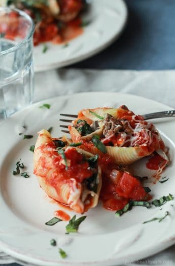 An easy Stuffed Shells recipe with ground beef, spinach, and mushrooms then topped with a homemade marinara sauce - all for only 223 calories per serving! | joyfulhealthyeats.com #recipes